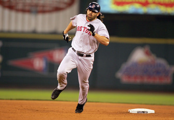 ST LOUIS - OCTOBER 27:  Johnny Damon #18 of the Boston Red Sox heads for third base on a triple hit in the sixth inning against the St. Louis Cardinals during game four of the World Series on October 27, 2004 at Busch Stadium in St. Louis, Missouri. (Phot