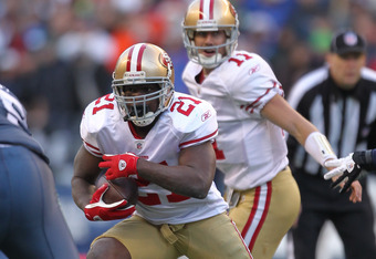 SEATTLE - DECEMBER 24:  Running back Frank Gore #21 of the San Francisco 49ers rushes against the Seattle Seahawks at CenturyLink Field on December 24, 2011 in Seattle, Washington. (Photo by Otto Greule Jr/Getty Images)