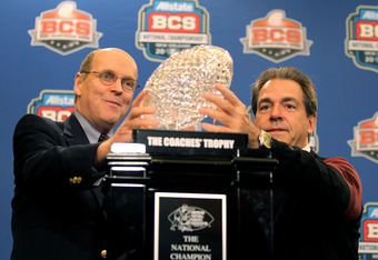 NEW ORLEANS, LA - JANUARY 10:  Bill Hancock the executive director of the Bowl Championship Series and Head coach Nick Saban of the Alabama Crimson Tide hold The Coaches' Trophy which signifies the national champion after defeating Louisiana State Univers