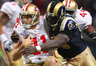 ST. LOUIS, MO - JANUARY 1: James Hall #96 of the St. Louis Rams sacks Alex Smith #11 of the San Francisco 49ers at the Edward Jones Dome on January 1, 2012 in St. Louis, Missouri.  The 49ers beat the Rams 34-27.  (Photo by Dilip Vishwanat/Getty Images)