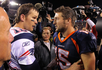 DENVER, CO - DECEMBER 18:  Quarterback Tom Brady #12 of the New England Patriots talks with quarterback Tim Tebow #15 of the Denver Broncos after the game at Sports Authority Field at Mile High on December 18, 2011 in Denver, Colorado. The Patriots defeat