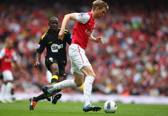 LONDON, ENGLAND - SEPTEMBER 24:  Per Mertesacker of Arsenal controls the ball during the Barclays Premier League match between Arsenal and Bolton Wanderers at Emirates Stadium on September 24, 2011 in London, England.  (Photo by Clive Mason/Getty Images)