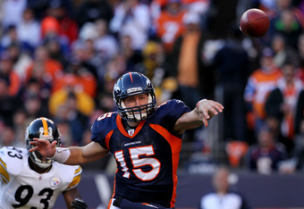 DENVER, CO - JANUARY 08:  Tim Tebow #15 of the Denver Broncos throws the ball against the Pittsburgh Steelers during the AFC Wild Card Playoff game at Sports Authority Field at Mile High on January 8, 2012 in Denver, Colorado.  (Photo by Jeff Gross/Getty