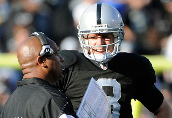 OAKLAND, CA - JANUARY 01:  Carson Palmer #3 talks with head coach Hue Jackson of the Oakland Raiders during a time out against the San Diego Chargers at O.co Coliseum on January 1, 2012 in Oakland, California.  (Photo by Thearon W. Henderson/Getty Images)