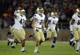 STANFORD, CA - NOVEMBER 26:  Bennett Jackson #2 of the Notre Dame Fighting Irish celebrates after recovering a fumble against the Stanford Cardinal at Stanford Stadium on November 26, 2011 in Stanford, California.  (Photo by Ezra Shaw/Getty Images)