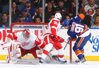 UNIONDALE, NY - JANUARY 10:  Ty Conklin #29 of the Detroit Red Wings lets the puck go in off of a score by Matt Moulson #26 of the New York Islanders as John Tavares #91 of the Islanders watches during their game on January10, 2012 at the Nassau Coliseum