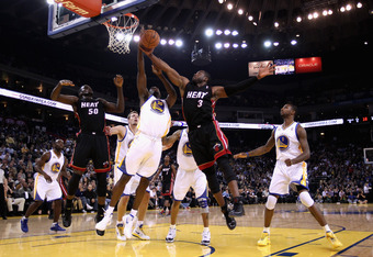 OAKLAND, CA - JANUARY 10:  Dwyane Wade #3 of the Miami Heat goes up for a shot against Ekpe Udoh #20 of the Golden State Warriors at Oracle Arena on January 10, 2012 in Oakland, California.  NOTE TO USER: User expressly acknowledges and agrees that, by do