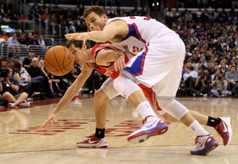 LOS ANGELES, CA - JANUARY 04:   Blake Griffin #32 of the Los Angeles Clippers steals a pass intended for Chandler Parsons #25 of the Houston Rockets at Staples Center on January 4, 2012 in Los Angeles, California.  NOTE TO USER: User expressly acknowledge
