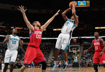 NEW ORLEANS, LA - JANUARY 04:  Jarrett Jack #2 of the New Orleans Hornets makes a shot over Spencer Hawes #0 of the Philadelphia 76ers at New Orleans Arena on January 4, 2012 in New Orleans, Louisiana.  NOTE TO USER: User expressly acknowledges and agrees