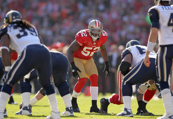 SAN FRANCISCO, CA - DECEMBER 04:  Patrick Willis #52 of the San Francisco 49ers lines up against the St. Louis Rams at Candlestick Park on December 4, 2011 in San Francisco, California.  (Photo by Ezra Shaw/Getty Images)