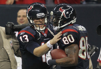 HOUSTON, TX - JANUARY 07:  (L-R) T.J. Yates #13 and Andre Johnson #80 of the Houston Texans celebrate after Johnson scored a 40-yard touchdown reception throw by Yates in the third quarter against the Cincinnati Bengals during their 2012 AFC Wild Card Pla