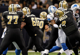 NEW ORLEANS, LA - JANUARY 07:  Willie Young #79 of the Detroit Lions causes  Drew Brees #9 of the New Orleans Saints to fumble the ball in the second quarter during their 2012 NFC Wild Card Playoff game at Mercedes-Benz Superdome on January 7, 2012 in New