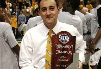 Chattanooga Head Coach John Shulman Proudly Holds SoCon Title Trophy After The Mocs Defeated UNCG 66-62 At The McKenzie Arena At The Conclusion Of The 2004-05 Season, Which Was Also Shulman's First As Head Coach In The Scenic City (Photo Courtesy Of The Chattanoogan.Com)