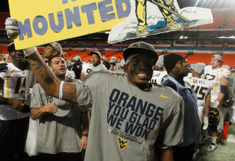 MIAMI GARDENS, FL - JANUARY 04:  J.D. Woods #81 of the West Virginia Mountaineers celebrates after they won 70-33 against the Clemson Tigers during the Discover Orange Bowl at Sun Life Stadium on January 4, 2012 in Miami Gardens, Florida.  (Photo by Stree