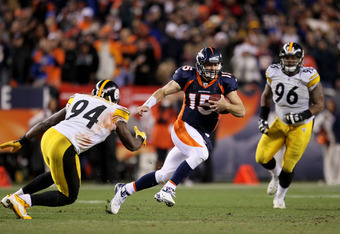 DENVER, CO - JANUARY 08:  Tim Tebow #15 of the Denver Broncos scrambles to pass the ball to Demaryius Thomas #88 of the Denver Broncos to score an 80 yard touchdown in overtime of the AFC Wild Card Playoff game at Sports Authority Field against the Pittsb