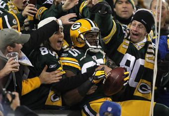 GREEN BAY, WI - NOVEMBER 14:  Greg Jennings #85 of the Green Bay Packers celebrates with fans after he scored on a 24-yard touchdown reception in the first quarter against the Minnesota Vikings at Lambeau Field on November 14, 2011 in Green Bay, Wisconsin