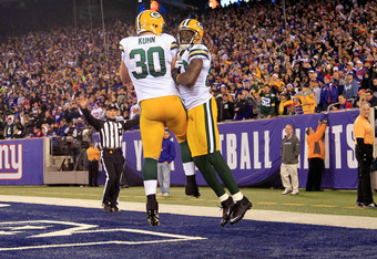 EAST RUTHERFORD, NJ - DECEMBER 04:  (L-R) Donald Driver #80 and John Kuhn #30 of the Green Bay Packers celebrate after Driver caught a 13-yard touchdown reception in the second quarter against the New York Giants at MetLife Stadium on December 4, 2011 in
