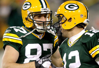 GREEN BAY, WI - DECEMBER 25:  Jordy Nelson #87 and quarterback Aaron Rodgers #12 of the Green Bay Packers celebrate a touchdown in the fourth quarter against the Chicago Bears at Lambeau Field on December 25, 2011 in Green Bay, Wisconsin.  (Photo by Matth