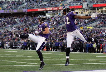 BALTIMORE, MD - DECEMBER 11:  Dennis Pitta #88 of the Baltimore Ravens catches a touchdown pass in front of teammate Torrey Smith #82 during the second half against the Indianapolis Colts at M&T Bank Stadium on December 11, 2011 in Baltimore, Maryland.  (