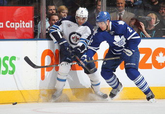 TORONTO, CANADA - JANUARY 5:  Evander Kane #9 of the Winnipeg Jets battles with Luke Schenn #2 of the Toronto Maple Leafs in a game on January 5, 2012 at the Air Canada Centre in Toronto, Canada. (Photo by Claus Andersen/Getty Images)