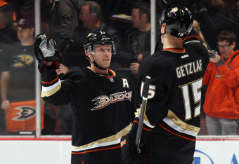 ANAHEIM, CA - JANUARY 10: Saku Koivu #11 and Ryan Getzlaf #15 of the Anaheim Ducks celebrate their 5-2 victory over the Dallas Stars at the Honda Center on January 10, 2012 in Anaheim, California.  (Photo by Bruce Bennett/Getty Images)