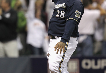 MILWAUKEE, WI - OCTOBER 10:  Prince Fielder #28 of the Milwaukee Brewers reacts after he scored on a 2-run home run by Rickie Weeks #23 in the bottom of the fourth inning against the St. Louis Cardinals during Game Two of the National League Championship