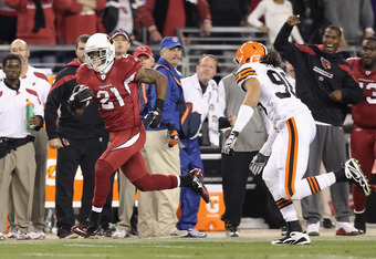 GLENDALE, AZ - DECEMBER 18:  Cornerback Patrick Peterson #21 of the Arizona Cardinals returns a punt in overtime past linebacker Quinton Spears #90 of the Cleveland Browns during the NFL game at the University of Phoenix Stadium on December 18, 2011 in Gl