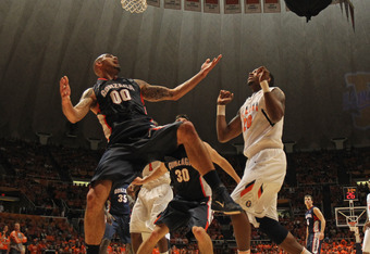 CHAMPAIGN, IL - DECEMBER 03: Robert Sacre #00 of the Gonzaga Bulldogs tries for a rebound against Myke Henry #20 of the Illinois Fighting Illini at Assembly Hall on December 3, 2011 in Champaign, Illinois. Illinois defeated Gonzaga 82-75.  (Photo by Jonat