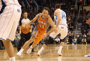 PHOENIX, AZ - DECEMBER 26:  Steve Nash #13 of the Phoenix Suns handles the ball during the season openning NBA game against the New Orleans Hornets at US Airways Center on December 26, 2011 in Phoenix, Arizona.  The Hornets defeated the Suns 85-84. NOTE T