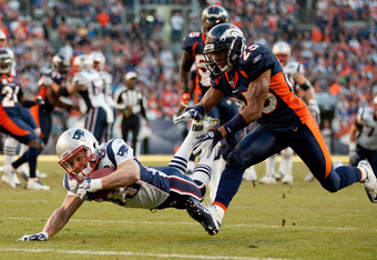 DENVER, CO - DECEMBER 18:  Wide receiver Wes Welker #83 of the New England Patriots is downed at the one yard line by cornerback Chris Harris #25 of the Denver Broncos during the second quarter at Sports Authority Field at Mile High on December 18, 2011 i
