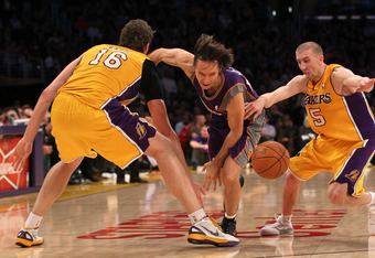 LOS ANGELES, CA - JANUARY 10:  Steve Nash #13 of the Phoenix Suns chases a loose ball against Pau Gasol #16 and Steve Blake #5 of the Los Angeles Lakers at Staples Center on January 10, 2012 in Los Angeles, California.  The Lakers won 99-83. NOTE TO USER: