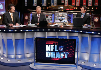 NEW YORK - APRIL 26:  The ESPN broadcast team of (L-R) Mel Kiper, Chris Mortensen, and Steve Young prepare for the 2008 NFL Draft on April 26, 2008 at Radio City Music Hall in New York, New York.  (Photo by Jim McIsaac/Getty Images)