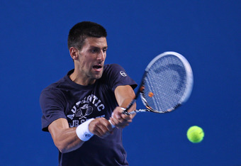 MELBOURNE, AUSTRALIA - JANUARY 11:  Novak Djokovic of Serbia plays a backhand during a practice session prior to the 2012 Australian Open at Rod Laver Arena on January 11, 2012 in Melbourne, Australia.  (Photo by Scott Barbour/Getty Images)