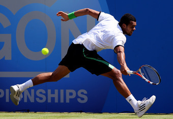 LONDON, ENGLAND - JUNE 13:  Jo-Wilfred Tsonga of France hits a backhand shot during his Men's Singles final against Andy Murray of Great Britain on day eight of the AEGON Championships at Queens Club on June 13, 2011 in London, England.  (Photo by Clive B