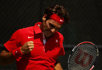 SYDNEY, AUSTRALIA - SEPTEMBER 18:  Roger Federer of Switzerland celebrates winning a point in his Davis Cup World Group Playoff Tie match against Bernard Tomic of Australia at Royal Sydney Golf Club on September 18, 2011 in Sydney, Australia.  (Photo by M