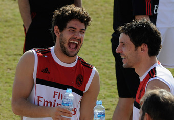 DUBAI, UNITED ARAB EMIRATES - DECEMBER 31:  Alexandre Pato (L) and Mark Van Bommel of AC Milan during training session at Al Rashid Stadium on December 31, 2011 in Dubai, United Arab Emirates.  (Photo by Claudio Villa/Getty Images)