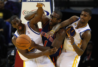 OAKLAND, CA - DECEMBER 28:  Amare Stoudemire #1 of the New York Knicks goes for a loose ball against Ekpe Udoh #20 and Dorell Wright #1 of the Golden State Warriors at Oracle Arena on December 28, 2011 in Oakland, California.  NOTE TO USER: User expressly