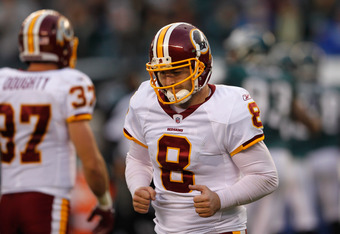 PHILADELPHIA, PA - JANUARY 01:  Rex Grossman #8 of the Washington Redskins jogs off the field after the Redskins failed to convert on third down against the Philadelphia Eagles during the secocnd half at Lincoln Financial Field on January 1, 2012 in Phila