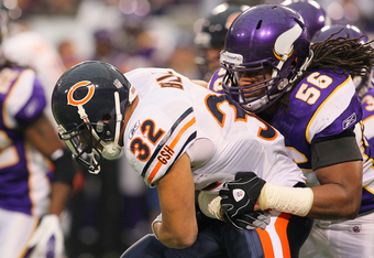 MINNEAPOLIS, MN - JANUARY 01:   Kahlil Bell #32 of the Chicago Bears carries the ball for a gain while  E.J. Henderson #56 of the Minnesota Vikings attempts the tackle at the Hubert H. Humphrey Metrodome on January 01, 2012 in Minneapolis, Minnesota.  (Ph