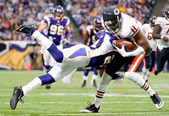 MINNEAPOLIS, MN - JANUARY 1: Asher Allen #21 of the Minnesota Vikings tackles Roy Williams #11 of the Chicago Bears during the fourth quarter on January 1, 2012 at Mall of America Field at the Hubert H. Humphrey Metrodome in Minneapolis, Minnesota. The Be