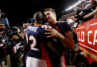 DENVER, CO - JANUARY 08:  Tim Tebow #15 of the Denver Broncos celebrates with teammate Elvis Dumervil #92 after defeating the Pittsburgh Steelers in overtime of the AFC Wild Card Playoff game at Sports Authority Field at Mile High on January 8, 2012 in De
