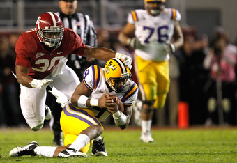 TUSCALOOSA, AL - NOVEMBER 05:  Dont'a Hightower #30 of the Alabama Crimson Tide tackles Jordan Jefferson #9 of the LSU Tigers during their game at Bryant-Denny Stadium on November 5, 2011 in Tuscaloosa, Alabama.  (Photo by Streeter Lecka/Getty Images)