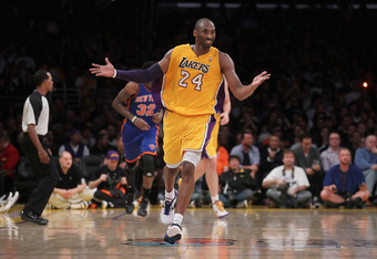 LOS ANGELES, CA - DECEMBER 29:  Kobe Bryant #24 of the Los Angeles Lakers gestures after making a basket and being fouled in the second half against the New York Knicks at Staples Center on December 29, 2011 in Los Angeles, California. NOTE TO USER: User