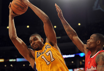 LOS ANGELES, CA - DECEMBER 19:  Andrew Bynum #17 of the Los Angeles Lakers grabs a rebound in front of Marcus Hubbard #21 of the Los Angeles Clippers at Staples Center on December 19, 2011 in Los Angeles, California. NOTE TO USER: User expressly acknowled