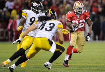 SAN FRANCISCO, CA - DECEMBER 19: Kendall Hunter #32 of the San Francisco 49ers looks to put a move on Troy Polamalu #43 of the Pittsburgh Steeler at Candlestick Park on December 19, 2011 in San Francisco, California. The 49ers won the game 20-3. (Photo by