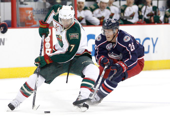 COLUMBUS,OH - NOVEMBER 06:  Matt Cullen #7 of the Minnesota Wild attempts to protect the puck from Samuel Pahlsson #26 of the Columbus Blue Jackets on November 6, 2010 at Nationwide Arena in Columbus, Ohio.  (Photo by John Grieshop/Getty Images)