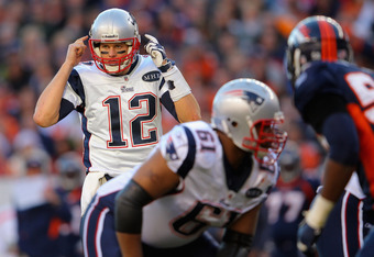 DENVER, CO - DECEMBER 18:  Quarterback Tom Brady #12 of the New England Patriots runs the offense against the Denver Broncos at Sports Authority Field at Mile High on December 18, 2011 in Denver, Colorado. The Patriots defeated the Broncos 41-23.  (Photo