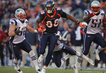 DENVER, CO - DECEMBER 18:  Demaryius Thomas #88 of the Denver Broncos makes a reception against the New England Patriots at Sports Authority Field at Mile High on December 18, 2011 in Denver, Colorado. The Patriots defeated the Broncos 41-23.  (Photo by D