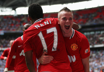LONDON, ENGLAND - AUGUST 07:  Tom Cleverley of Manchester United celebrates with goalscorer Nani after he scores the winning goal during the FA Community Shield match sponsored by McDonald's between Manchester City and Manchester United at Wembley Stadium