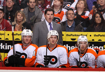 GLENDALE, AZ - DECEMBER 03:  Head coach Peter Laviolette of the Philadelphia Flyers reacts on the bench during the NHL game against the Phoenix Coyotes at Jobing.com Arena on December 3, 2011 in Glendale, Arizona.  (Photo by Christian Petersen/Getty Image